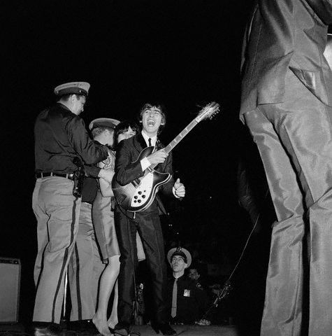 George Harrison Mobbed by Fan During Concert
