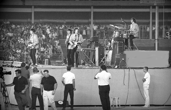 Peter Simon remembers watching the Beatles on the Ed Sullivan Show, and the following year, photographed their concert at Shea Stadium.